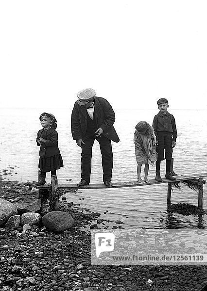 A man with three children on a jetty  Landskrona  Sweden  1910. Artist: Unknown