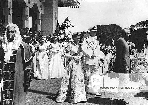 The Queen in her Coronation robes after opening the third session of the Parliament of Ceylon  19 Artist: Unknown