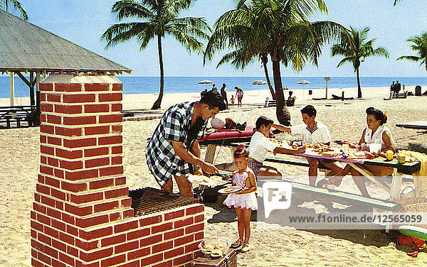 A family enjoying a picnic and barbecue on a sandy beach in Florida  USA  1957. Artist: Unknown