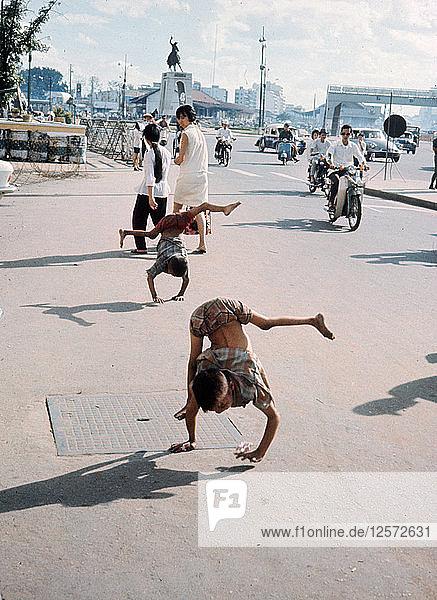 Children walking on their hands  Saigon  Vietnam  1959-1975. Artist: Unknown