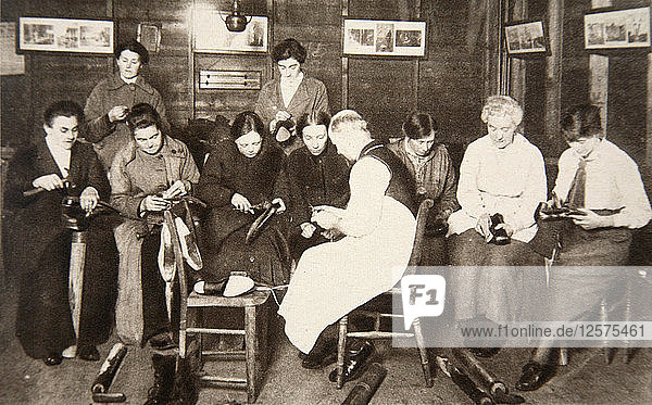A group of women receive a lesson in boot repairing  World War I  c1914-c1918. Artist: S and G