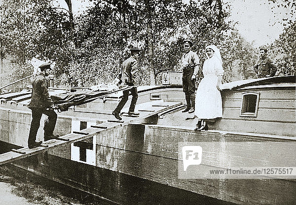 Patients being taken on board a hospital barge  Somme campaign  France  World War I  1916. Artist: Unknown