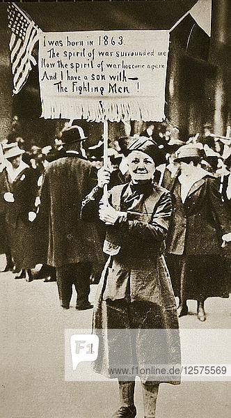 Woman holding a placard in support of the war effort  USA  World War I  c1914-c1918. Artist: Unknown