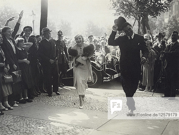 Max Schmeling and Anny Ondra arrive at the registry office to be married  1933. Artist: Unknown