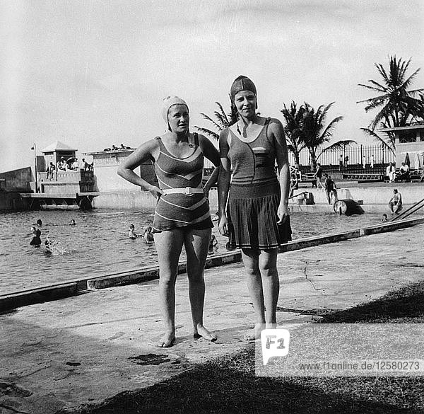 Two women in swimsuits beside a swimming pool  Balboa  Panama  1931. Artist: Unknown