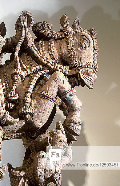 Wood carving of warrior prince on horseback  part of a processional chariot.