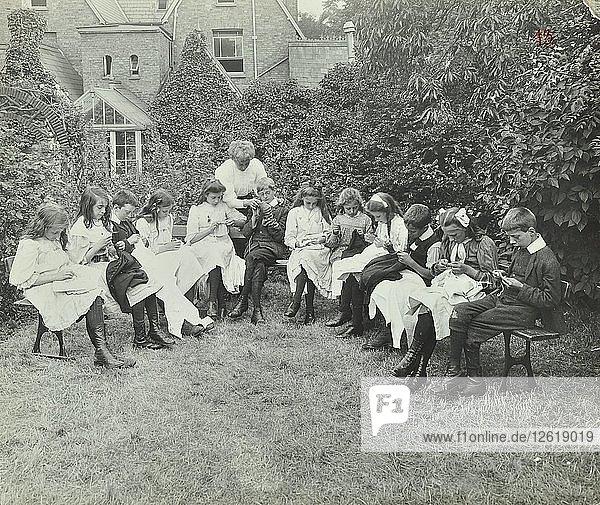 Pupils in the garden doing needlework  Birley House Open Air School  Forest Hill  London  1908. Artist: Unknown.