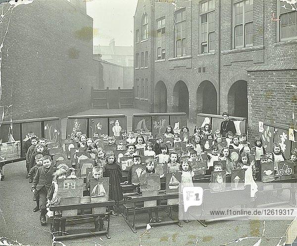 Children displaying their drawings  Flint Street School  Southwark  London  1908. Artist: Unknown.
