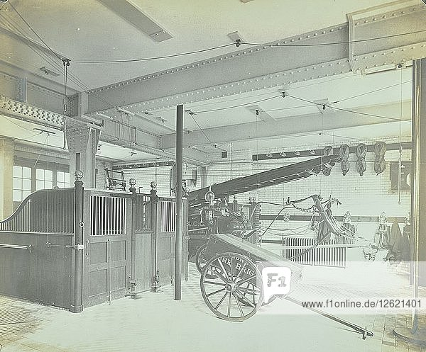 Interior of appliance room  Northcote Road Fire Station  Battersea  London  1906. Artist: Unknown.