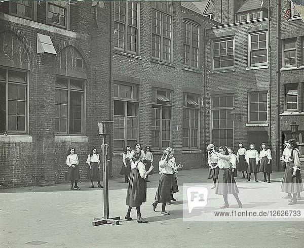 Girls playing netball in the playground  William Street Girls School  London  1908. Artist: Unknown.