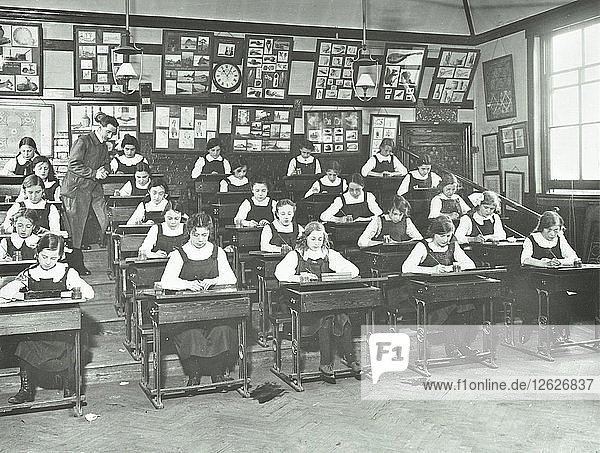 Girls in a classroom  Tollington Park Central School  London  1915. Artist: Unknown.