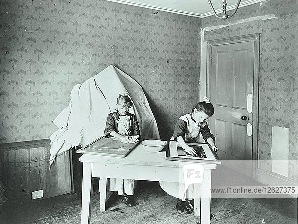 'Spring cleaning; housewifery lesson  Denmark Hill School  Dulwich  London  1908. Artist: Unknown.'