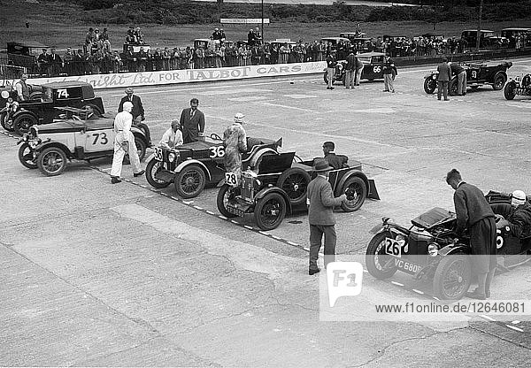 Cars on the starting grid at the JCC Members Day  Brooklands  4 July 1931 Artist: Bill Brunell.