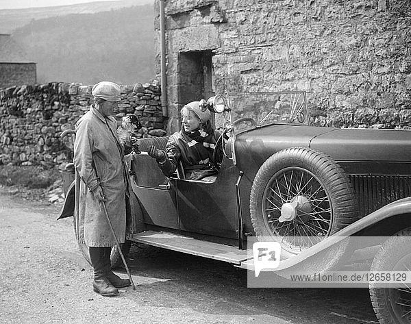 Kitty Brunell in a MG 18/80 open 4-seater  c1930(?). Artist: Bill Brunell.