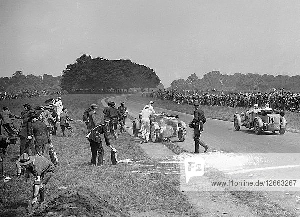 Recovering George Eystons fire-damaged Bugatti T43  Irish Grand Prix  Phoenix Park Dublin  1929. Artist: Bill Brunell.