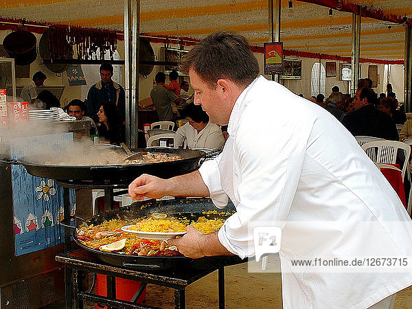 Mediterranean cuisine  chef preparing a paella  Feria de Abril (April Fair) 2002.