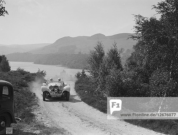 SS Jaguar 100 open 2-seater of Miss E Violet Watson competing in the RSAC Scottish Rally  1939. Artist: Bill Brunell.