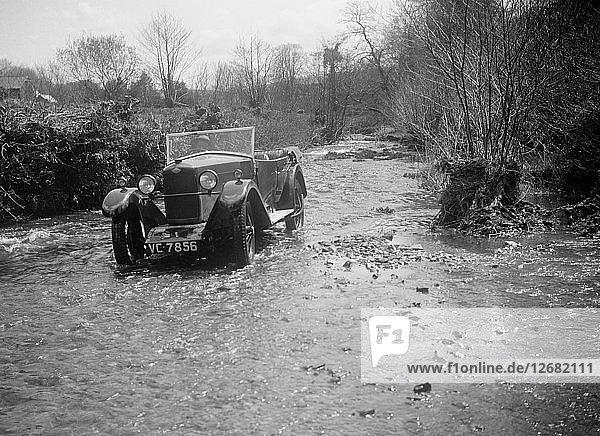 Kitty Brunell road testing a Riley 9 tourer  c1930. Artist: Bill Brunell.