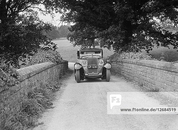 Kitty Brunell road testing a 1931 Delage D8. Artist: Bill Brunell.