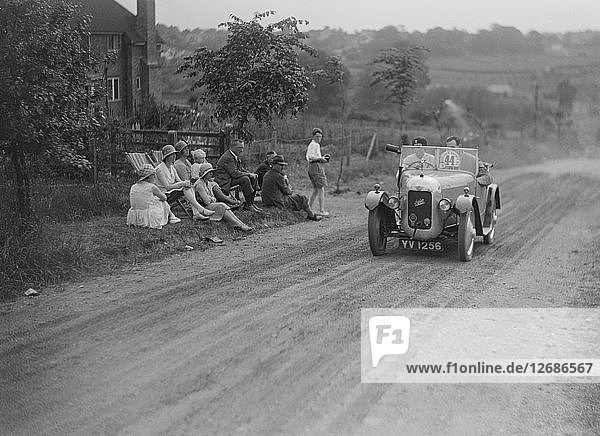 Austin Swallow of Mrs A Stanley competing in the Middlesex County AC Hill Climb  c1930. Artist: Bill Brunell.