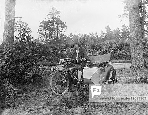 A woman riding a Douglas flat-twin motorcycle with a sidecar  1900-1910. Artist: Unknown.