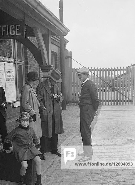 Group of people outside a Metropolitan Line railway station  London  1930s. Artist: Bill Brunell.