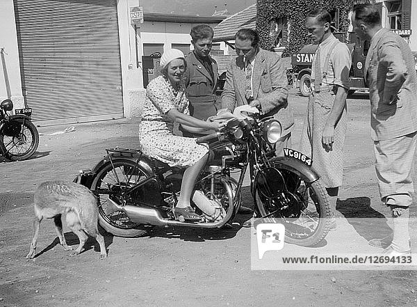 Betty Lemitte on a 499 cc Rudge Ulster motorcycle  1930s. Artist: Bill Brunell.