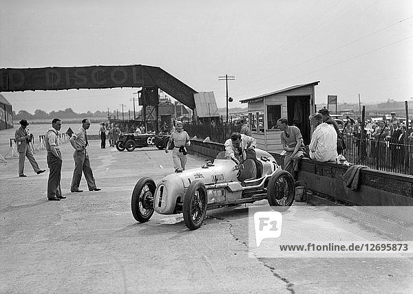 Kay Petre in an Austin 7 works team racing car  Brooklands  1937. Artist: Bill Brunell.