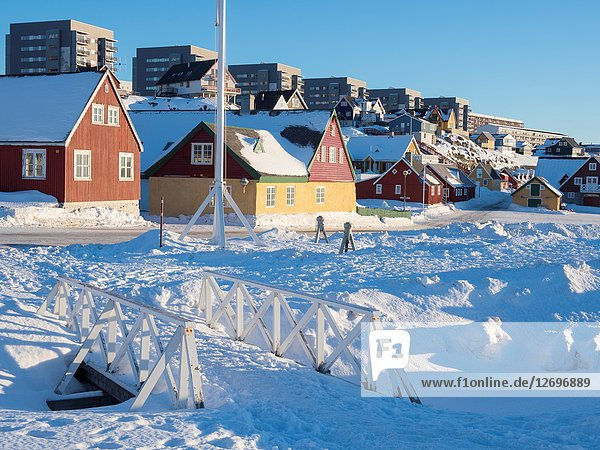 Hans Egede house in the old town modern quarters of Nuuk in the background. Nuuk  the capital of Greenland. America  North America  Greenland.