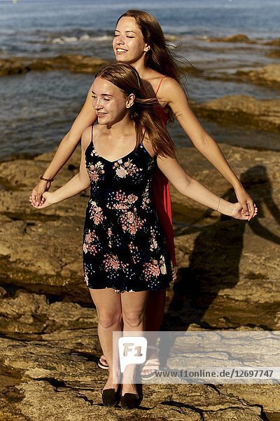Two women  friends  standing at beach two women  friends  at beach  togetherness in holiday destination Chersonisoss  Crete  Greece