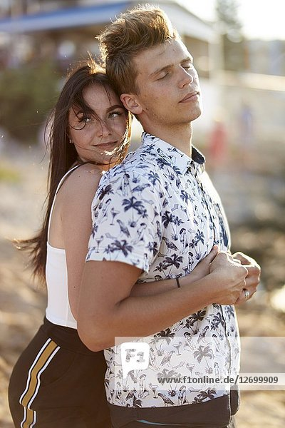 Woman hugging boyfriend from behind  couple  love  feelings. Chersonissos  Crete  Greece.