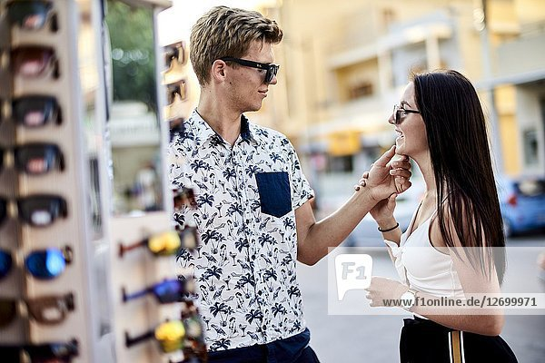 Couple choosing sunglasses at shop. Chersonissos  Crete  Greece.