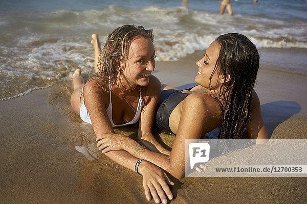 Two young women relaxing on beach. Chersonissos  Crete  Greece.