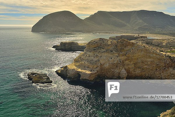 Coastline  Cabo de Gata Natural Park  with Playazo in background. Almeria province  Andalusia  Spain.