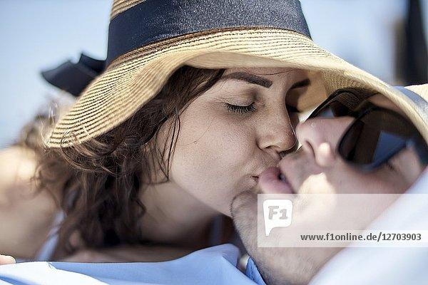 Woman kissing man  holiday  summer