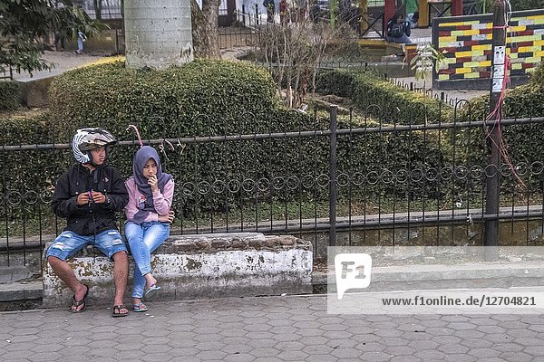 Couple sitting on the bench in Ciwidey  Bandung  Java  Indonesia
