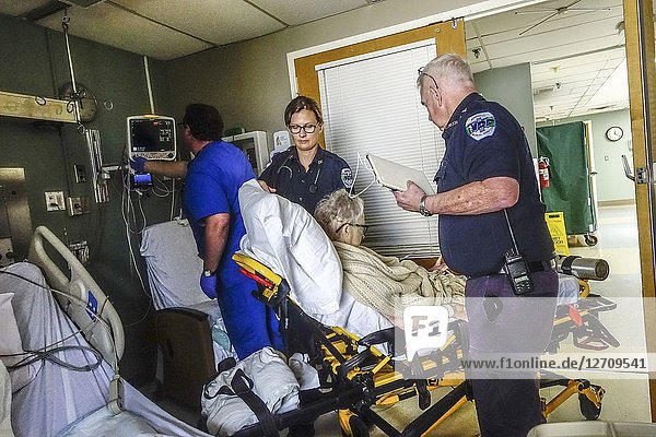 Sharon  Connecticut USA A senior woman gets transported out of the Intensive care unit by ambulance personel.