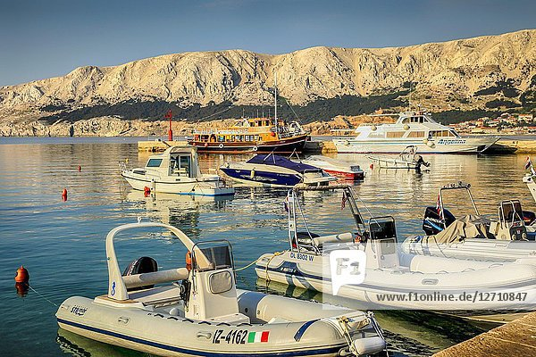 Variety of boats in the Croatian harbor village of Baska on the Island of Krk.