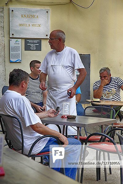 Chef visiting his patrons at the village restaurant in Vrbnik on the Croatian island of Krk.