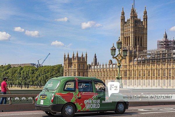London Taxi crossing the River Thames bridge near Parliament house.