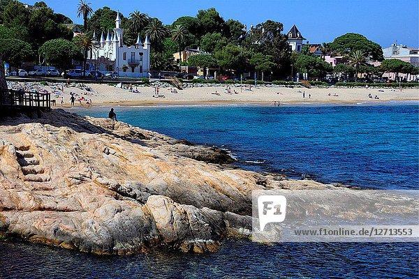Coastline in Sant Feliu de Guixols resort  in background Sant Pol sandy beach  Sant Feliu de Guixols  Costa Brava  Catalonia  Spain  Europe