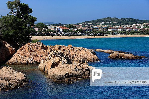 Sant Feliu de Guixols resort  rocky coastline  in background Sant Pol sandy beach  Sant Pol beach is a passage between resorts S'Agaro and Sant Feliu de Guixols  view for S'Agaro  Costa Brava  Baix Empordà   Catalonia  Spain  Europe