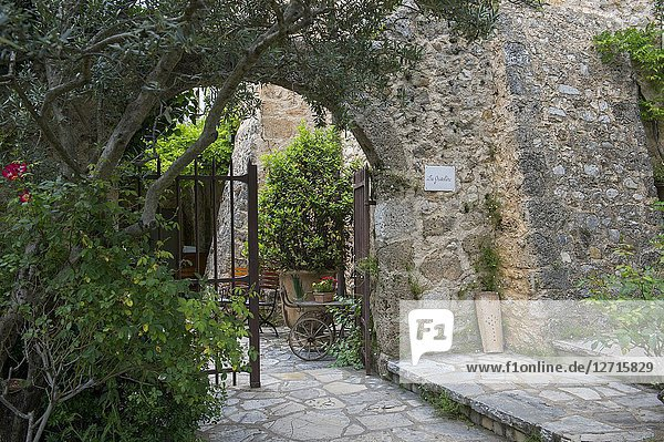 A gate at La Bastide de Moustiers  a house converted to a hotel  in Moustiers-Sainte-Marie  a medieval village in Alpes-de-Haute-Provence region in southern France.