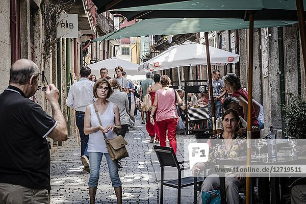 People walking in the beautiful and typical streets of Porto on a summer day. Portugal.