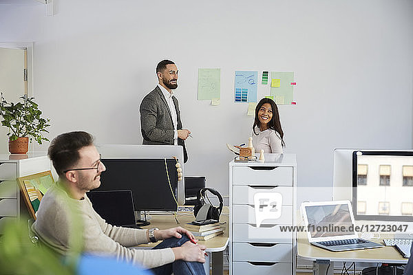 Smiling business colleagues in meeting at office