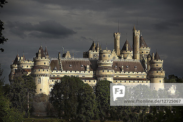 France,  Pieerefons castle,  general view of the West facade on a stormy evening.