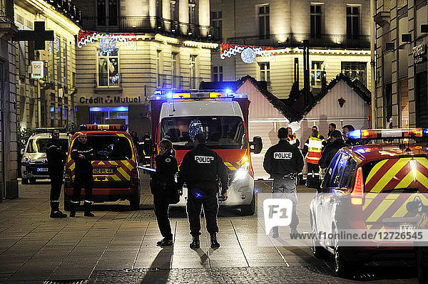 France  Nantes city  a car crashed into the crowd at the Christmas market  police and firemen in action  help on site.