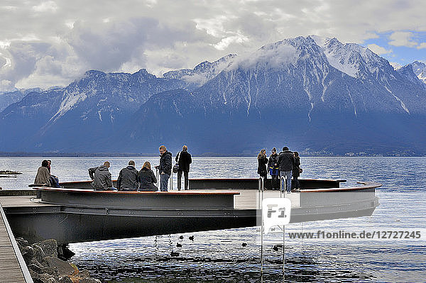Switzerland  Montreux  tourists on a pier above the Lake Geneva