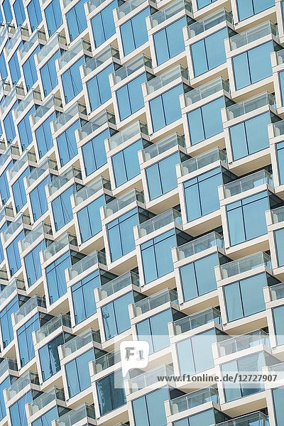 Detail of windows and balconies of new high rise apartment building in Downtown Dubai  UAE  United Arab Emirates.