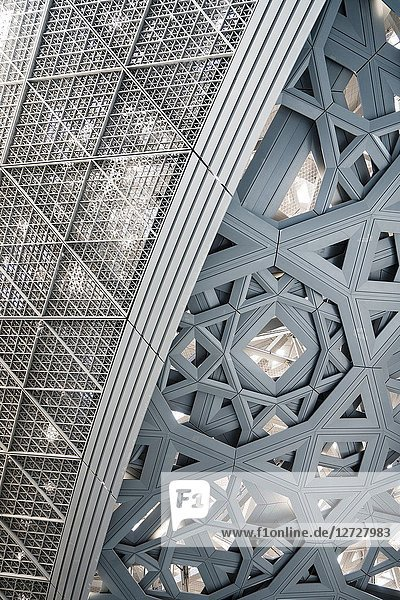 Interior of the Louvre Abu Dhabi with detail of the steel roof dome at Saadiyat Island Cultural District in Abu Dhabi  UAE. Architect Jean Nouvel.